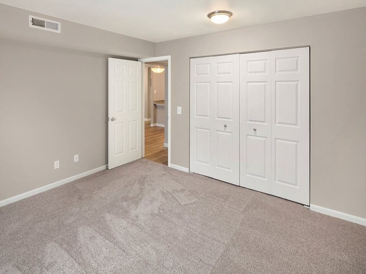 Carpeted bedrooms at Burwick Farms apartment homes