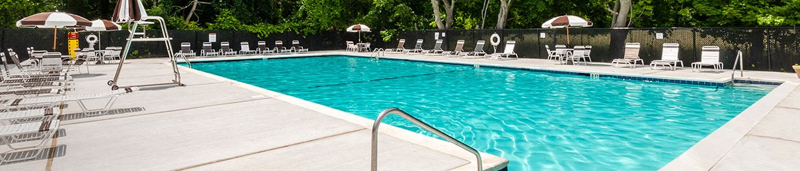exterior pool with trees in background at Heatherwood House at Port Jefferson, Port Jeff Station, New York