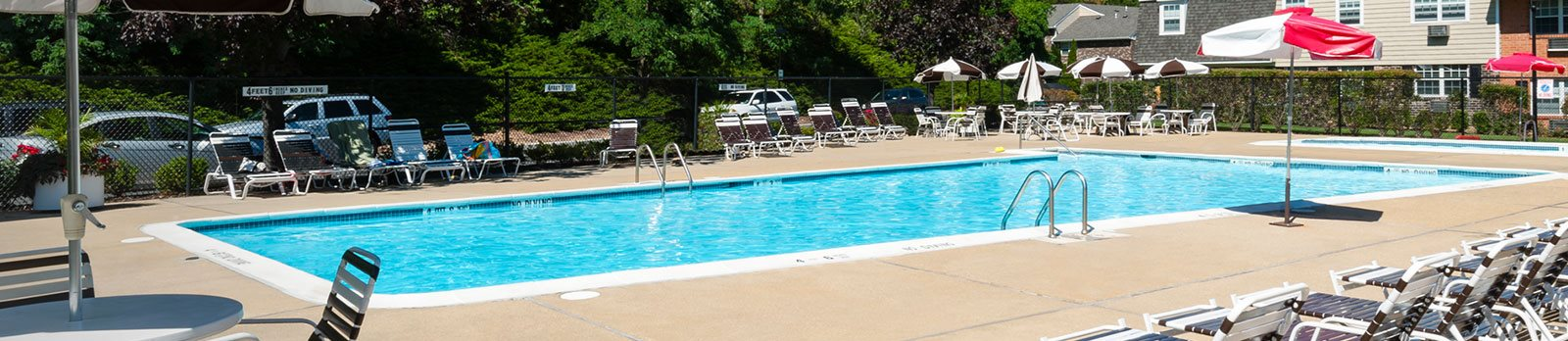 Swimming Pool With Relaxing Sundecks at Norwich Gate, East Norwich, New York