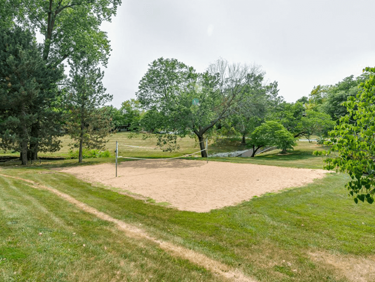 sand volleyball court at The Retreat at Woodridge apartments