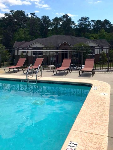 edge of pool with lounge chairs