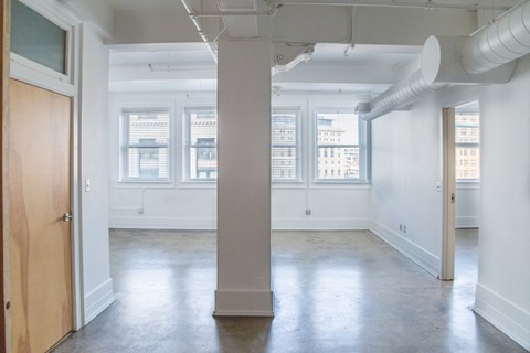 Large Living Space With Windows at 1525 Broadway, Michigan