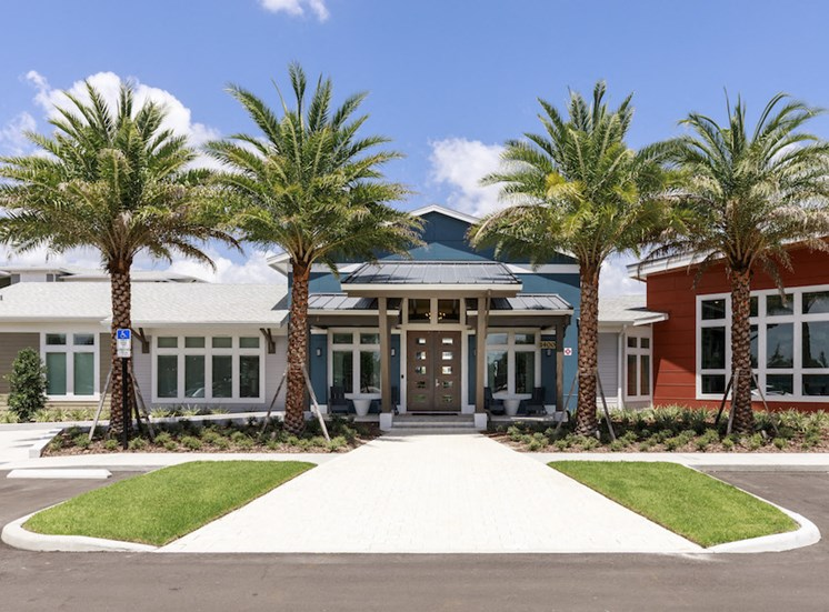 Clubhouse exterior with beautiful palm trees