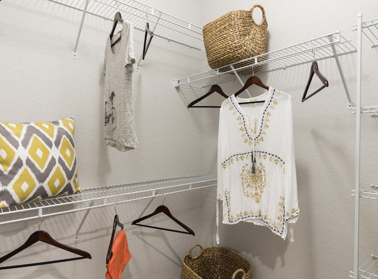 oversized closet with built in shelving and example storage