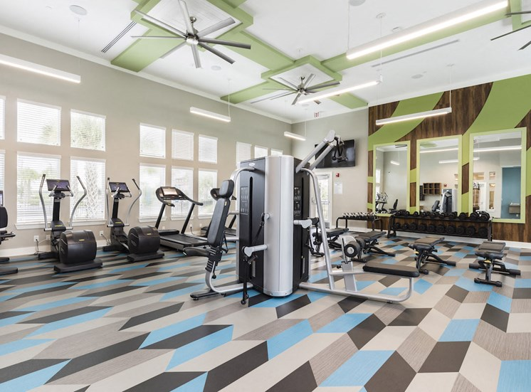 expansive fitness studio with weight tower and cardio machines