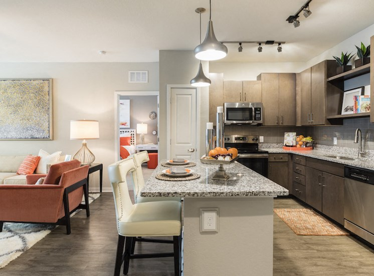 large open concept kitchen with eat-in island