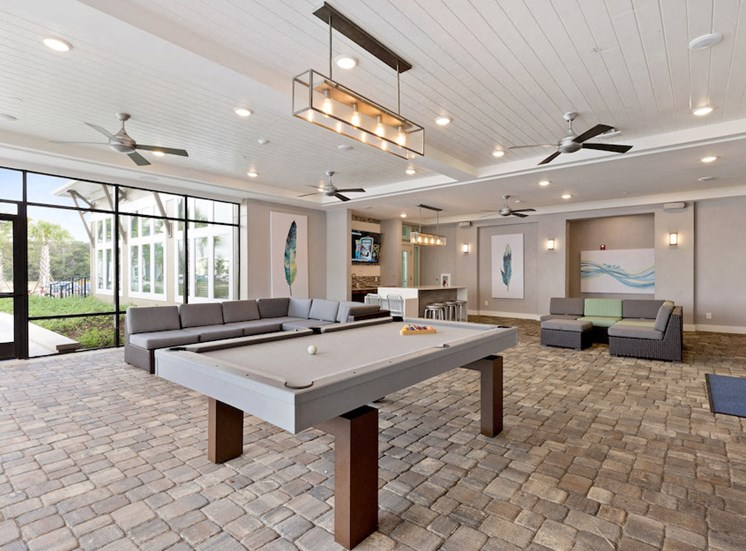 Ariel Apartments amenity deck with billiards and lounge seating