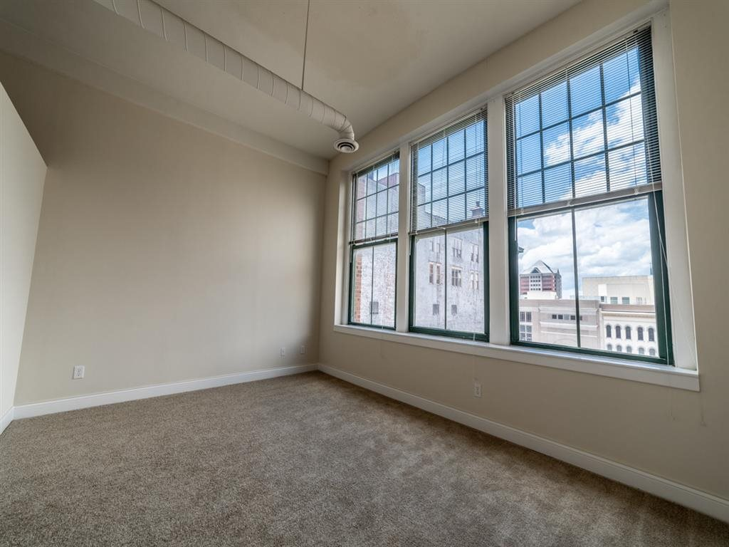 Living Room With Large Window  at Buckingham Urban Living, Indianapolis, IN