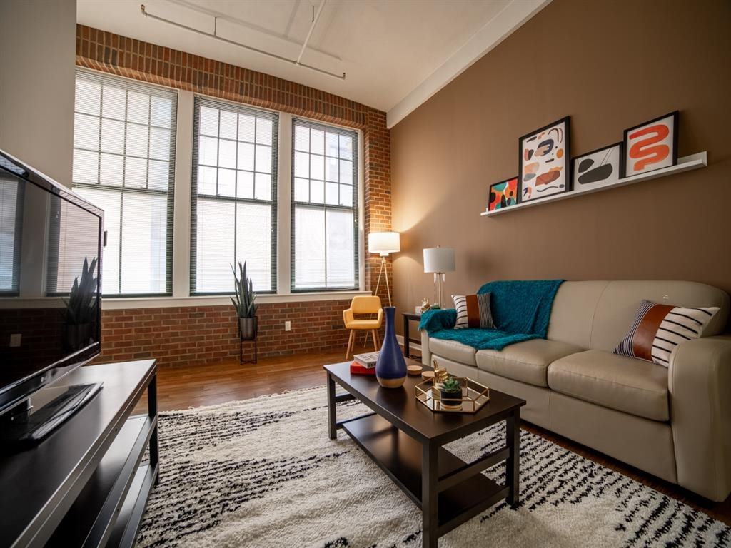 Living Room With Expansive Window at Buckingham Urban Living, Indiana