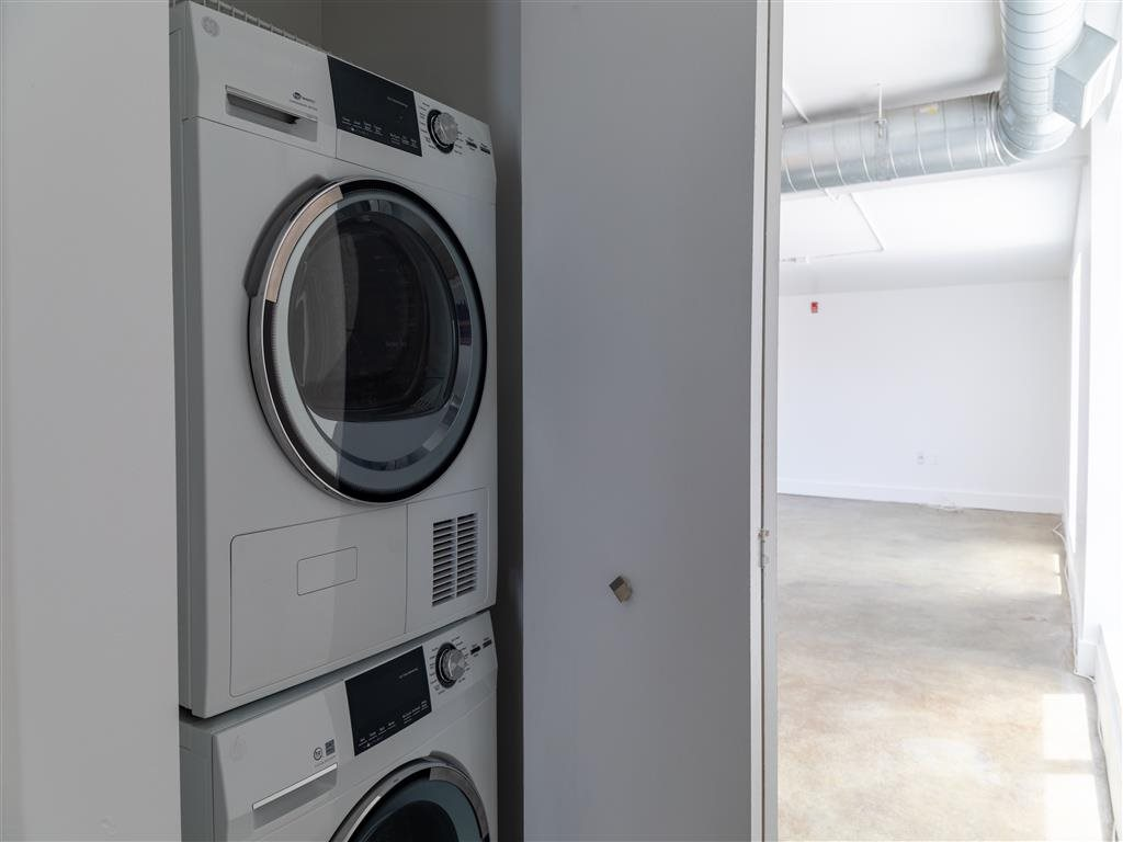 Bright Laundry Room at Buckingham Urban Living, Indianapolis, IN
