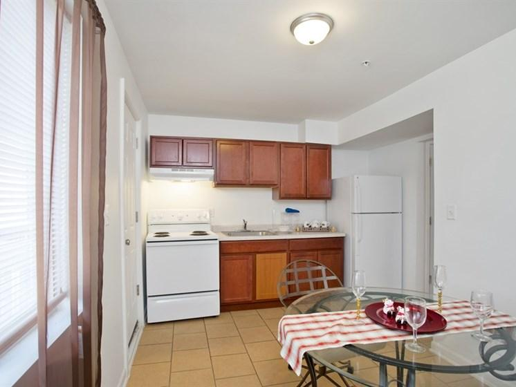 Kitchen at Pangea Oaks Apartments includes appliances and eat-in kitchen area.