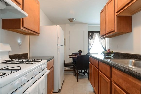 Pangea Parkwest Apartments in Indianapolis feature kitchens with appliances.