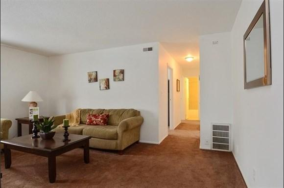 Apartments for rent at Pangea Parkwest in Indianapolis offer spacious living rooms.