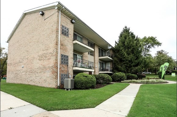 Pangea Pines Apartments in Baltimore, MD feature balconies and clean grounds.