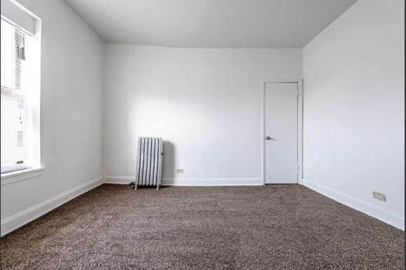Bedroom at 5854 S Michigan Ave Apartments