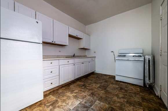 Kitchen at 5854 S Michigan Ave Apartments