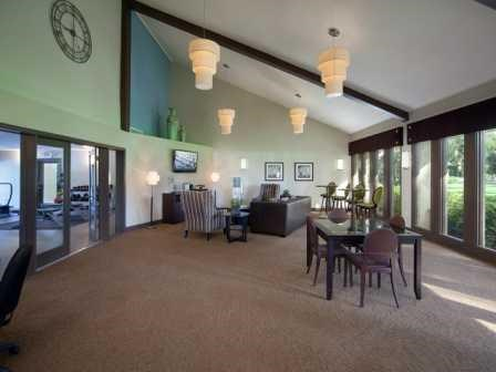 Clubhouse with sitting areas   L'Estancia Apartments in Sarasota FL