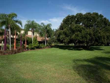 Beautiful green landscaping and trees at L'Estancia Apartments