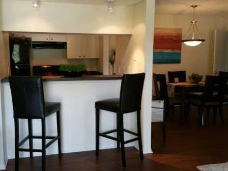 Kitchen with breakfast nook and separate dining area   L'Estancia Apartments