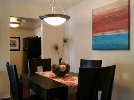 Dining Area and light at L'Estancia Apartments in Sarasota