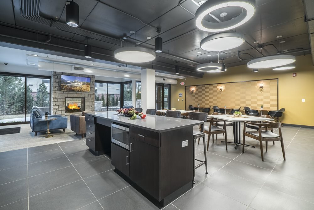 The Conrad clubhouse with kitchen and fireside seating-Blackstone District Omaha NE