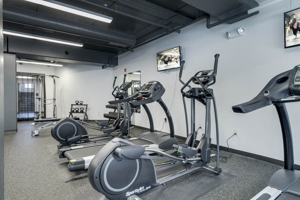 24-hour fitness center with TVs at The Conrad near UNMC in the Blackstone District Omaha NE 68105