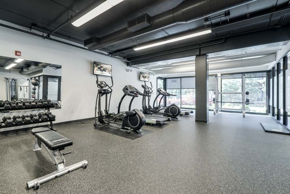 Fitness center with cardio and free weights at The Conrad near UNMC in the Blackstone District Omaha NE 68105