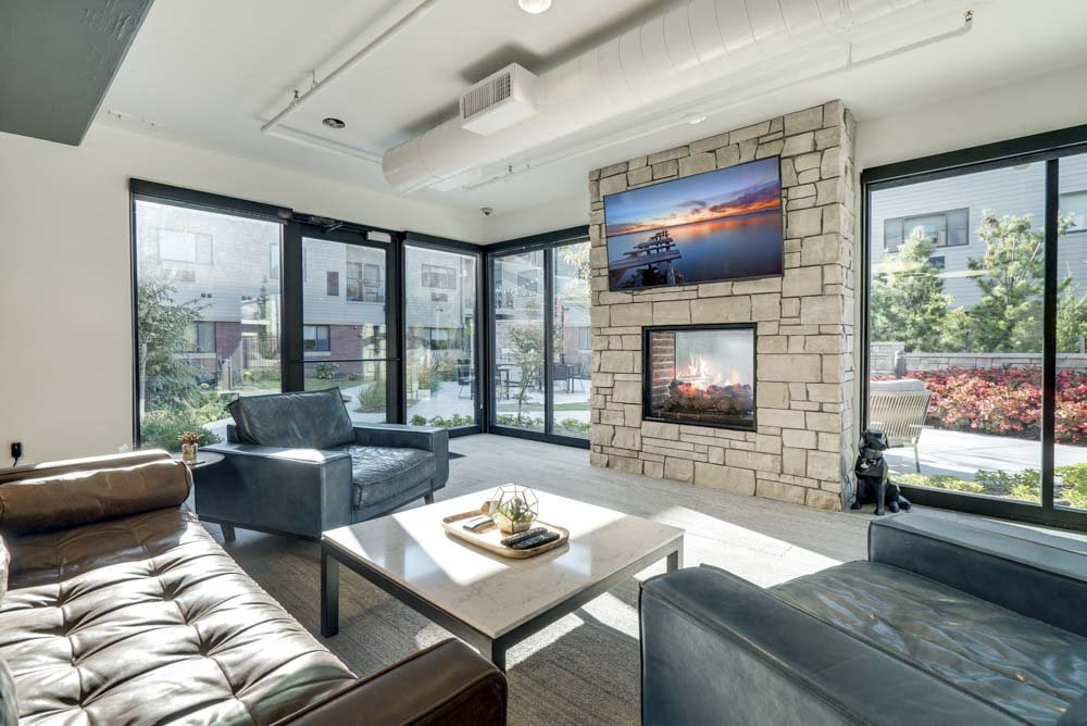 TV lounge with views of pocket park at The Conrad near UNMC in the Blackstone District Omaha NE 68105