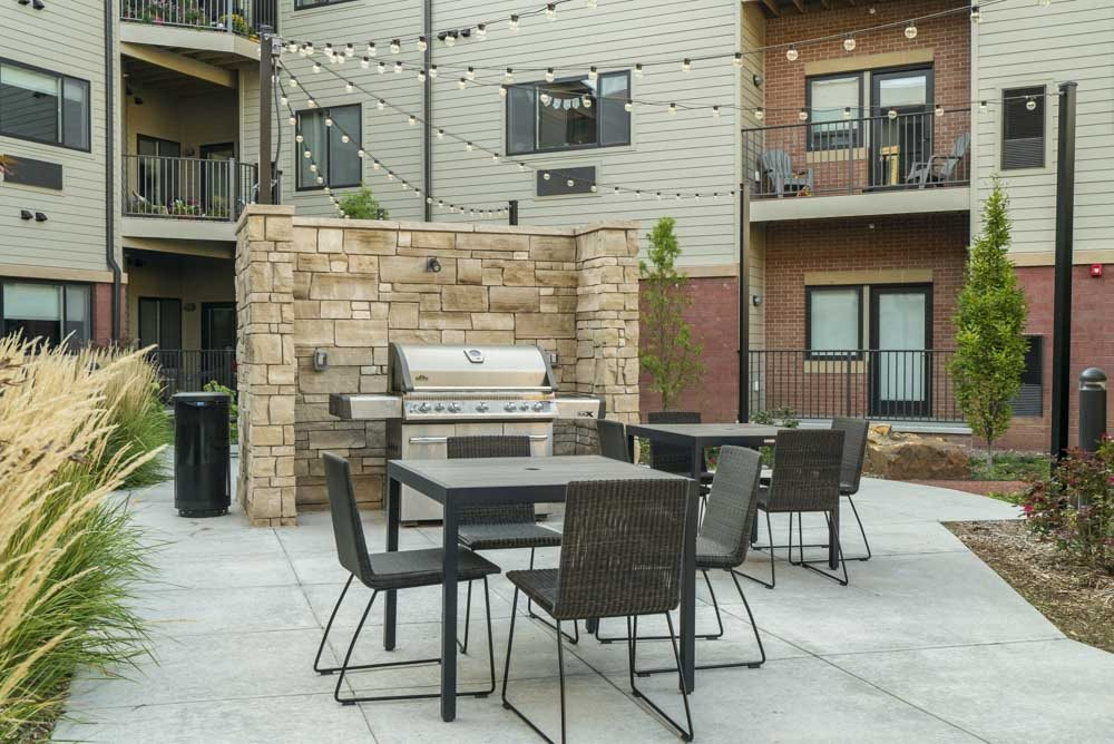 Outdoor grill and seating at The Conrad near UNMC in the Blackstone District Omaha NE 68105