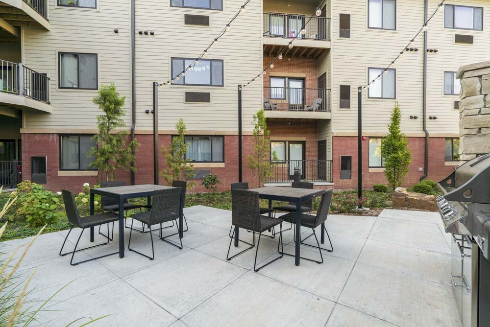 Outdoor seating with grills at The Conrad near UNMC in the Blackstone District Omaha NE 68105