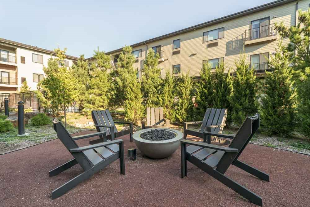 Outdoor fire pit in the pocket park at The Conrad near UNMC in the Blackstone District Omaha NE 68105