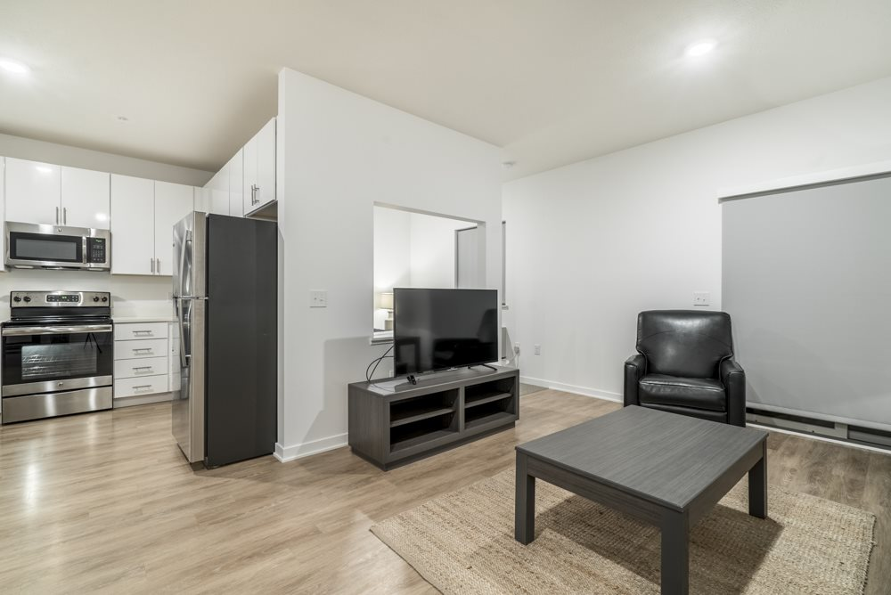 Studio apartment for rent with view of living room and kitchen in contemporary design near UNMC Omaha