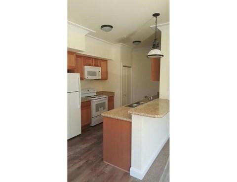Kitchen with fridge microwave and range