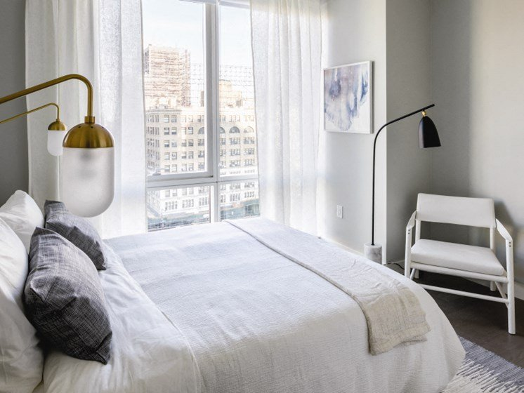 cozy bedroom with perfect decor at Tower 28, Long Island City