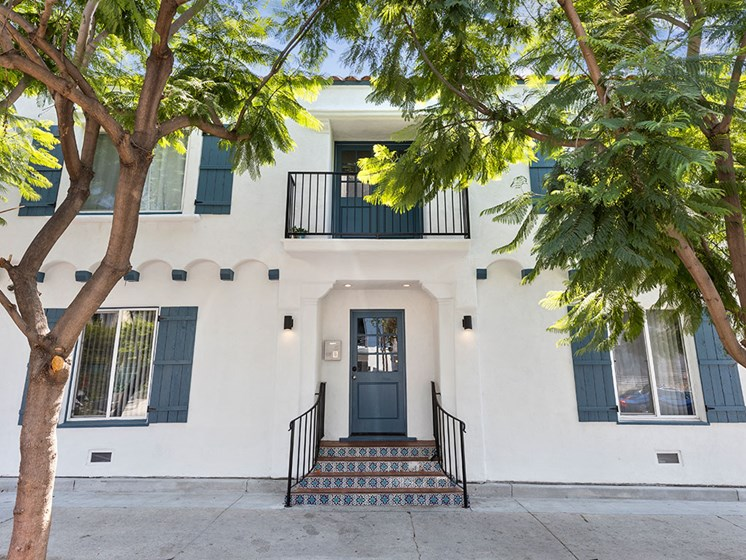 Property Front Entrance with Trees at Barton Apartments in Hollywood, California