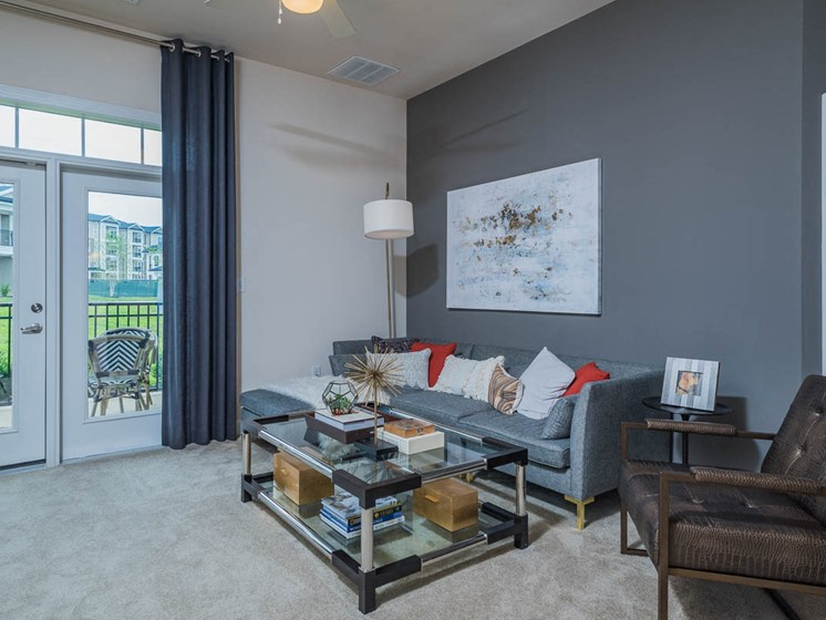 Spacious Living Room With Private Balcony at Abberly Waterstone Apartment Homes by HHHunt, Virginia, 22554