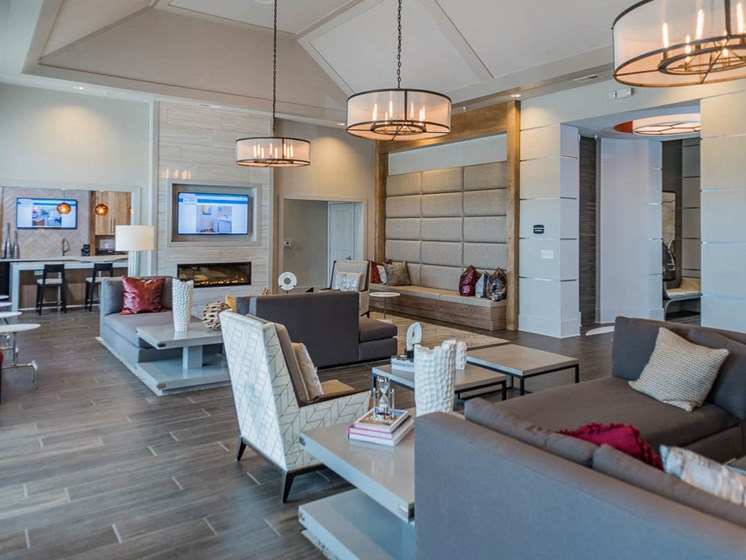 Warm Fireplace Sitting at Abberly Waterstone Apartment Homes by HHHunt, Virginia