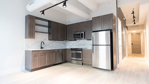 Refrigerator and microwave in kitchen at 35W, Michigan