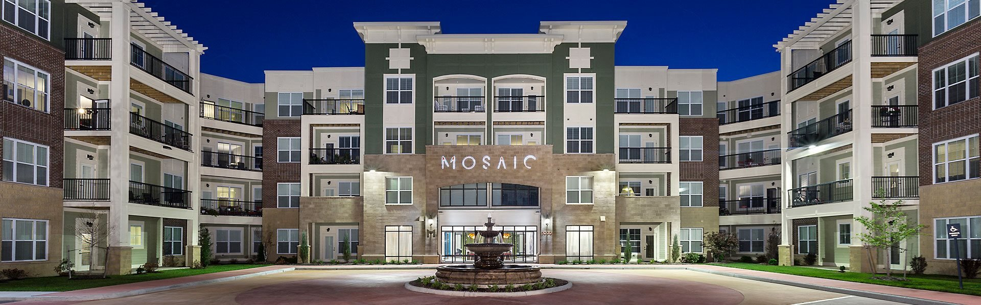 Exterior View of Mosaic at Levis Commons Apartments with fountain in Perrysburg, OH near Toledo