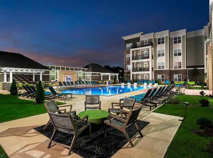 Poolside patio seating at Mosaic at Levis Commons Apartments in Perrysburg, OH near Toledo