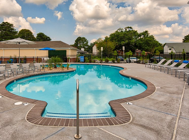 Pool and chairs at The Choices at Holland Windsor Apartments
