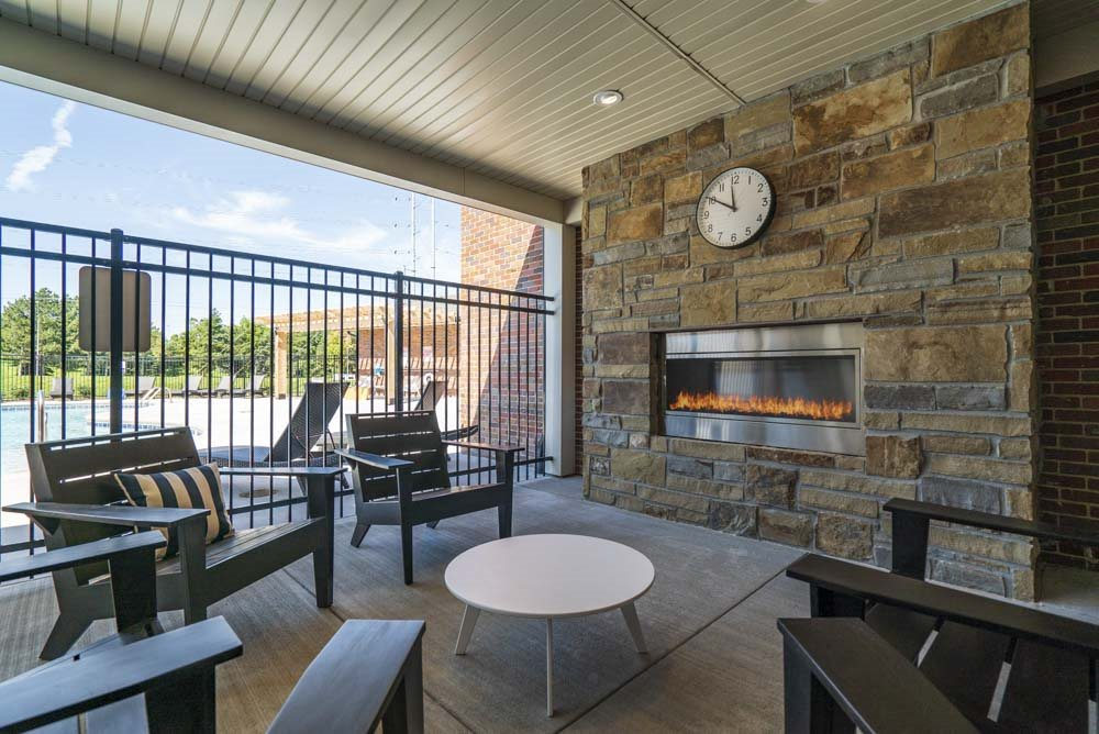 Seating by the outdoor fire place at The Villas at Mahoney Park