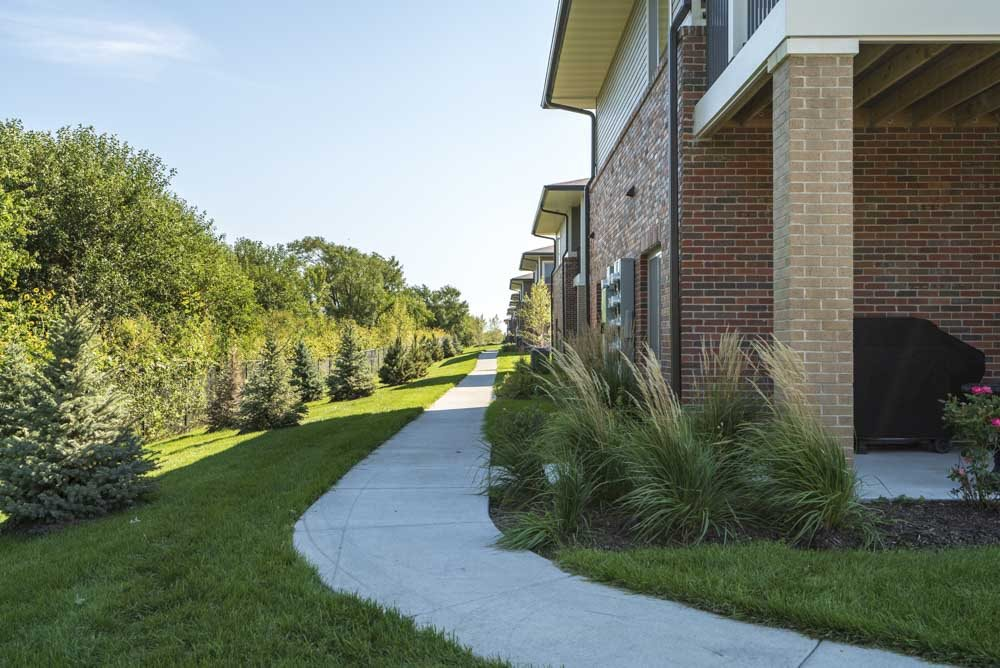 Walking paths leading to the buildings at The Villas at Mahoney Park
