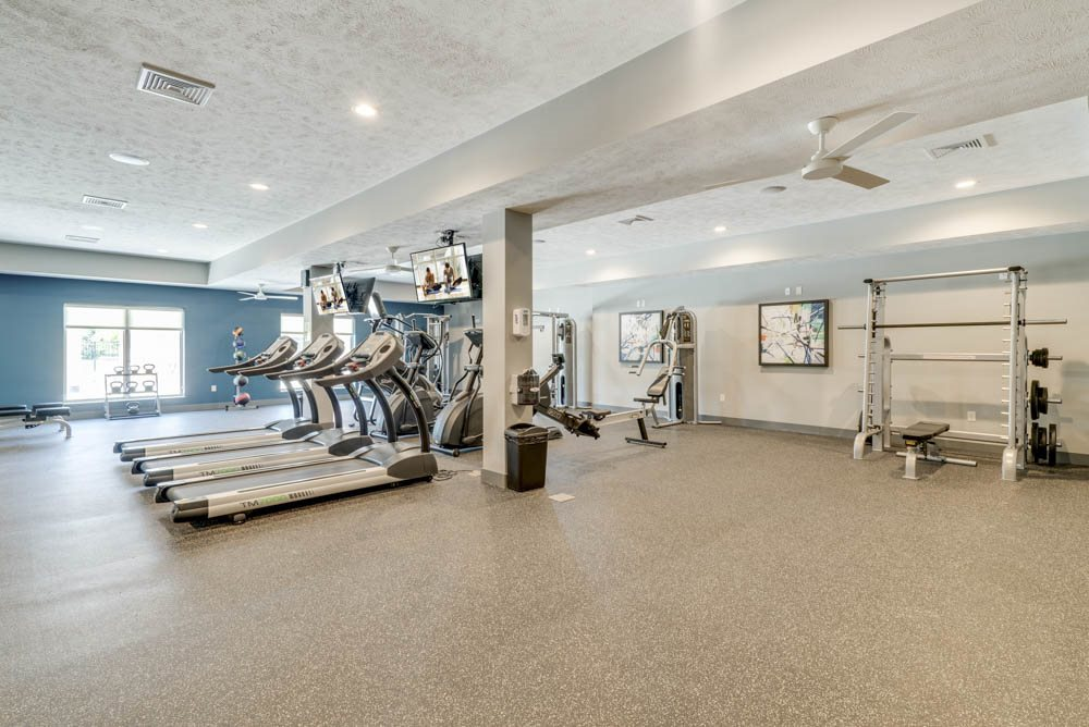 Large fitness center with a variety of equipment at The Villas at Mahoney Park