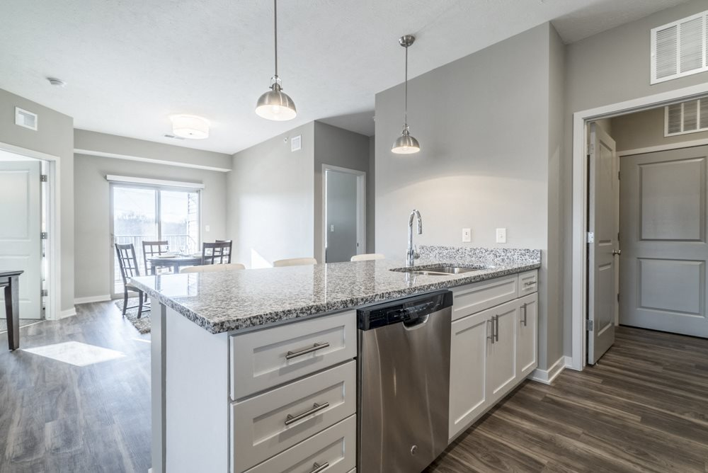 Kitchen with pendant lighting at The Villas at Mahoney Park