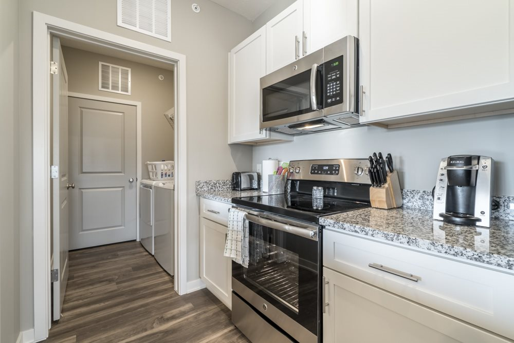 Kitchen including stainless steel smooth top stoves at The Villas at Mahoney Park