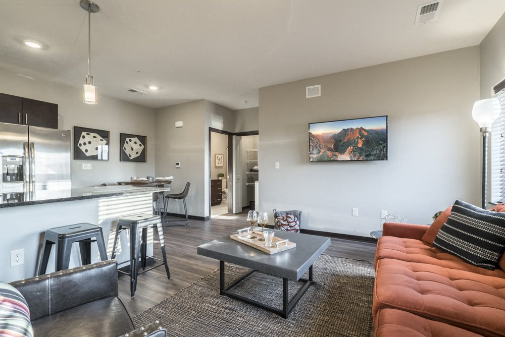 Modern and inviting open layout of living room and kitchen at The Villas at Mahoney Park