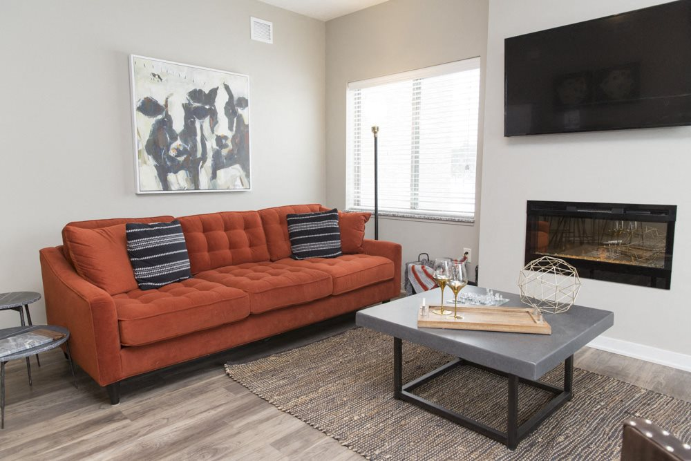 Living room space with fireplace at The Villas at Mahoney Park