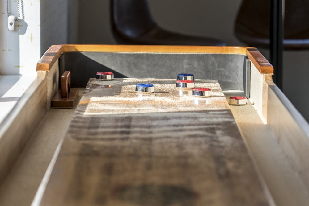 Shuffle board table in the clubhouse at The Villas at Mahoney Park