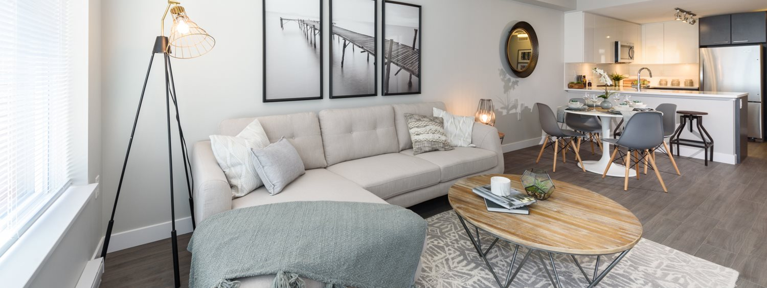 Living room with three paintings and a grey toned flooring